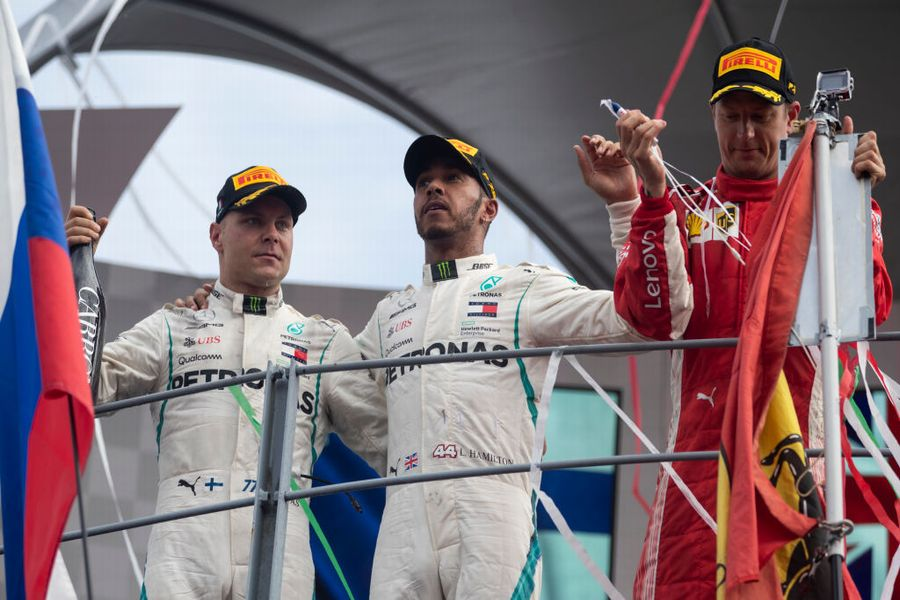 Top 3 drivers celebrate on the podium