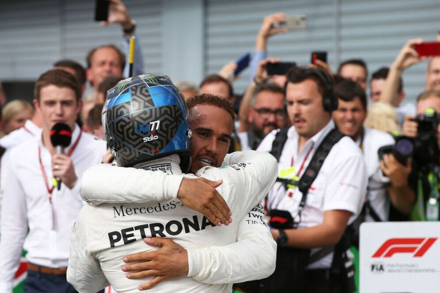 Race winner Lewis Hamilton and Valtteri Bottas celebrates in parc ferme