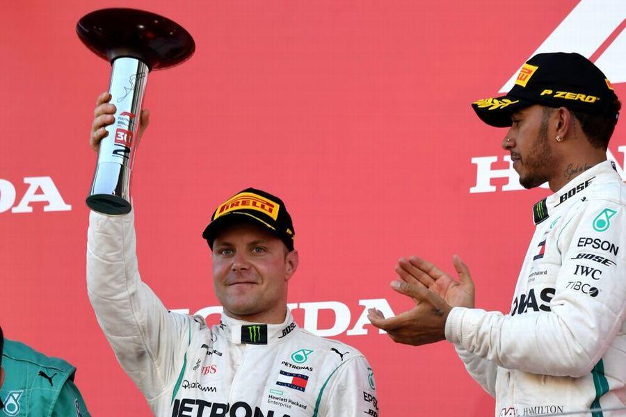 Valtteri Bottas celebrates on the podium with the trophy