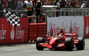 Kimi Raikkonen takes the chequered flag