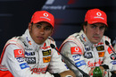 Lewis Hamilton (L) with McLaren team-mate Fernando Alonso