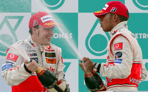 Fernando Alonso (L) and McLaren team-mate Lewis Hamilton celebrate a one-two in Malaysia
