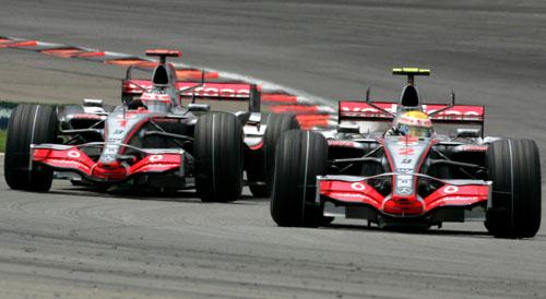 Lewis Hamilton leads McLaren team-mate Fernando Alonso
