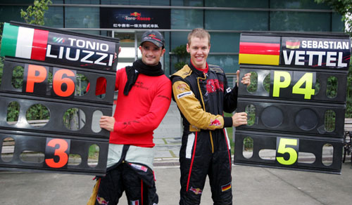 Tonio Liuzzi and Sebastian Vettel celebrate Toro Rosso's best ever race finish