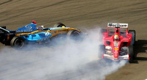 Renault's Fernando Alonso narrowly misses Felipe Massa's spinning Ferrari