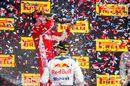 Race winner Kimi Raikkonen celebrates on the podium with the champagne