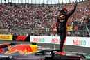Race winner Max Verstappen  celebrates in parc ferme