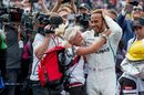 Lewis Hamilton celebrates in parc ferme with the team