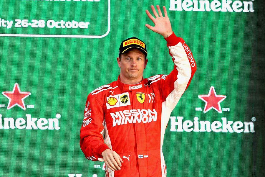 Kimi Raikkonen celebrates on the podium