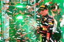 Race winner Max Verstappen celebrate on the podium with the champagne