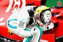 Race winner Lewis Hamilton celebrates in parc ferme