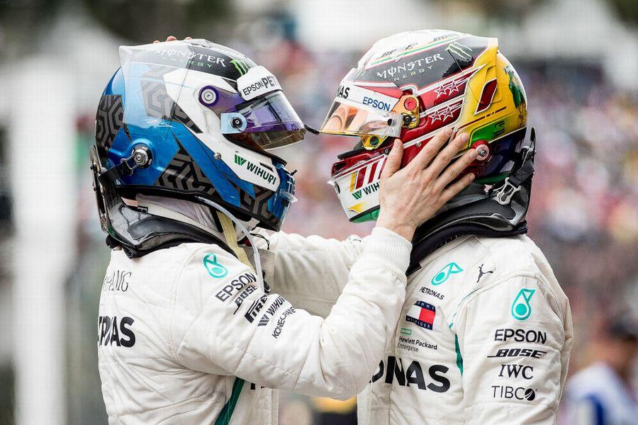 Race winner Lewis Hamilton and Valtteri Bottas celebrate in parc ferme