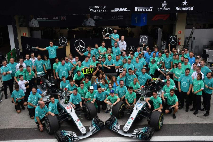 Lewis Hamilton celebrates with the Mercedes team after winning the F1 Brazil Grand Prix and taking the constructors title