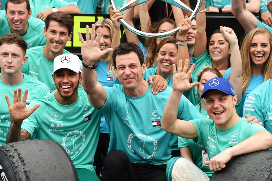 Lewis Hamilton, Valtteri Bottas, Toto Wolff and the rest of the Mercedes team celebrate after winning the F1 Constructors Championship