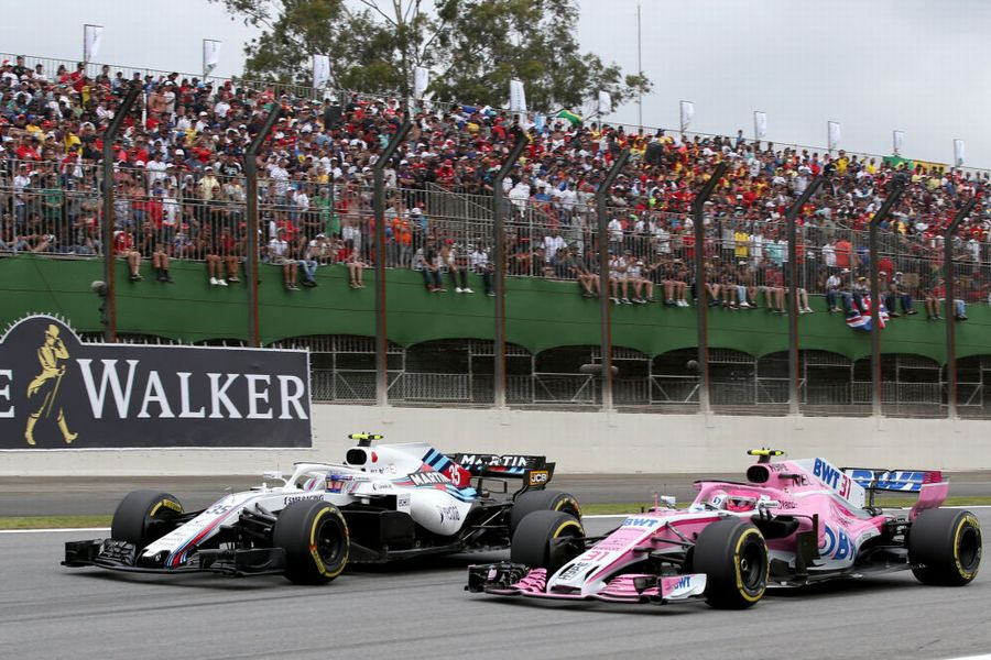 Sergey Sirotkin and Esteban Ocon battle for position