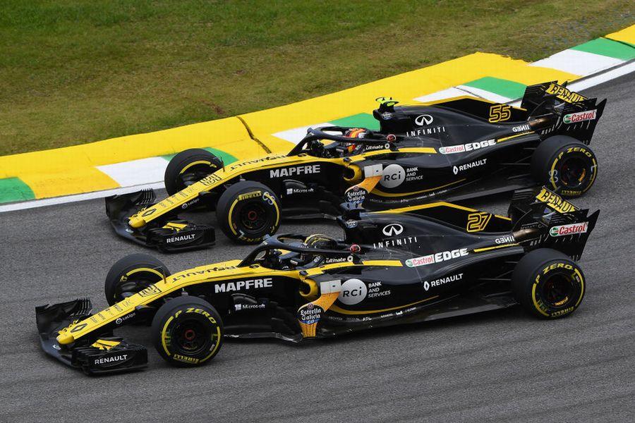 Nico Hulkenberg and Carlos Sainz battle for position