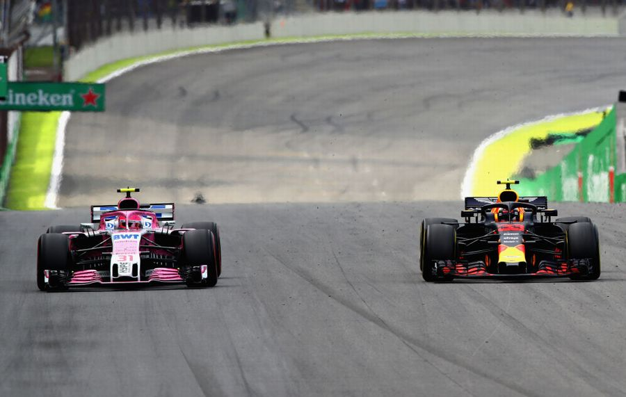 Esteban Ocon attempts to unlap himself from race leader Max Verstappen
