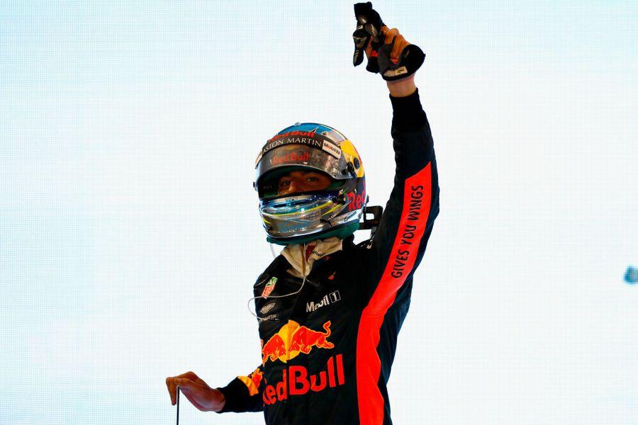 Daniel Ricciardo waves to the crowd from parc ferme