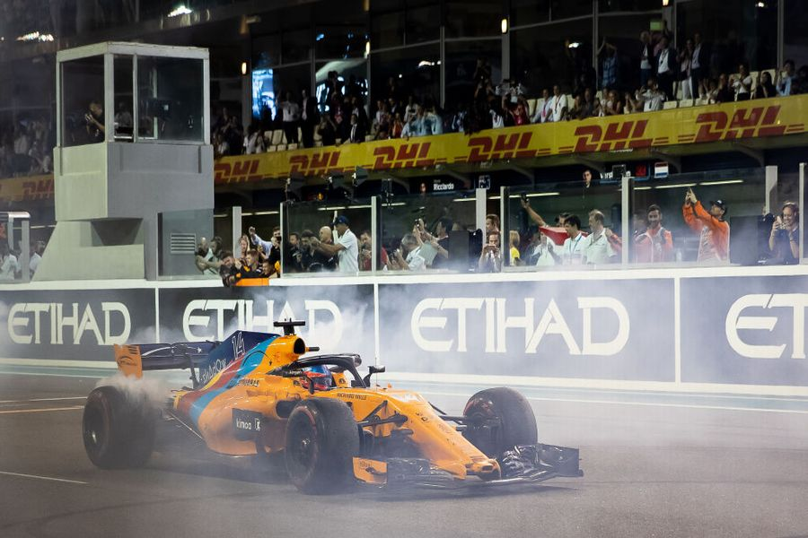Fernando Alonso performs donuts on the pit straight
