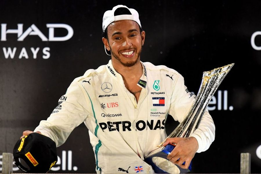 Race winner Lewis Hamilton celebrate on the podium