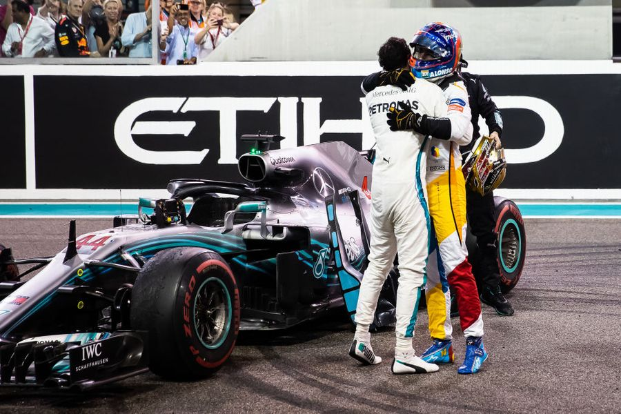 Race winner Lewis Hamilton celebrates with Fernando Alonso