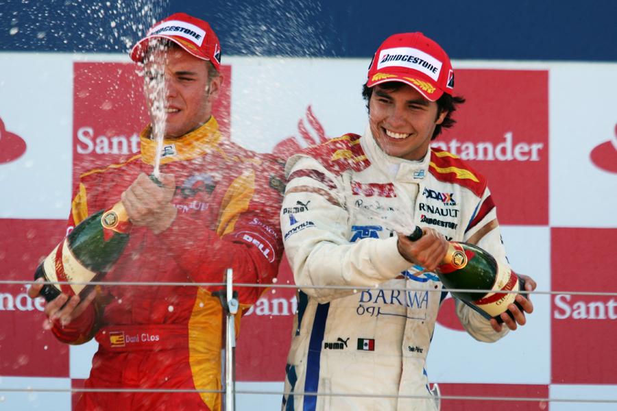 Sergio Perez celebrates his win alongside Dani Clos who finished third