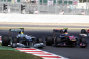 Nico Rosberg overtakes Jaime Alguersuari around the outside of Brooklands
