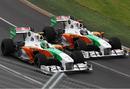 Tonio Liuzzi and Adrain Sutil go wheel-to-wheel