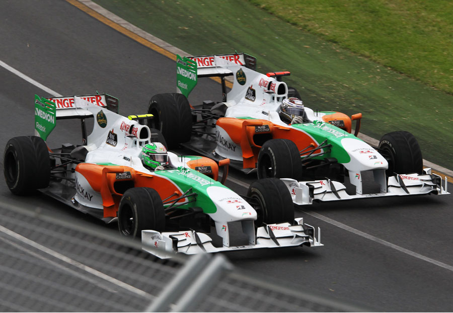 Tonio Liuzzi and Adrain Sutil go wheel-to-wheel