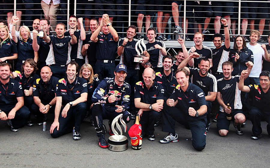 Mark Webber celebrates with his team