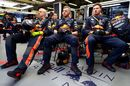 The Red Bull Racing team watch the action in the garage