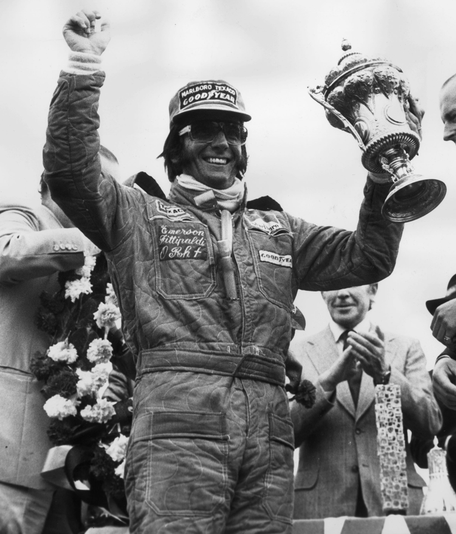Emerson Fittipaldi celebrates winning the British Grand Prix