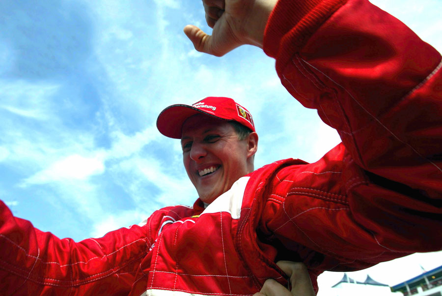 Michael Schumacher celebrates his fifth world championship