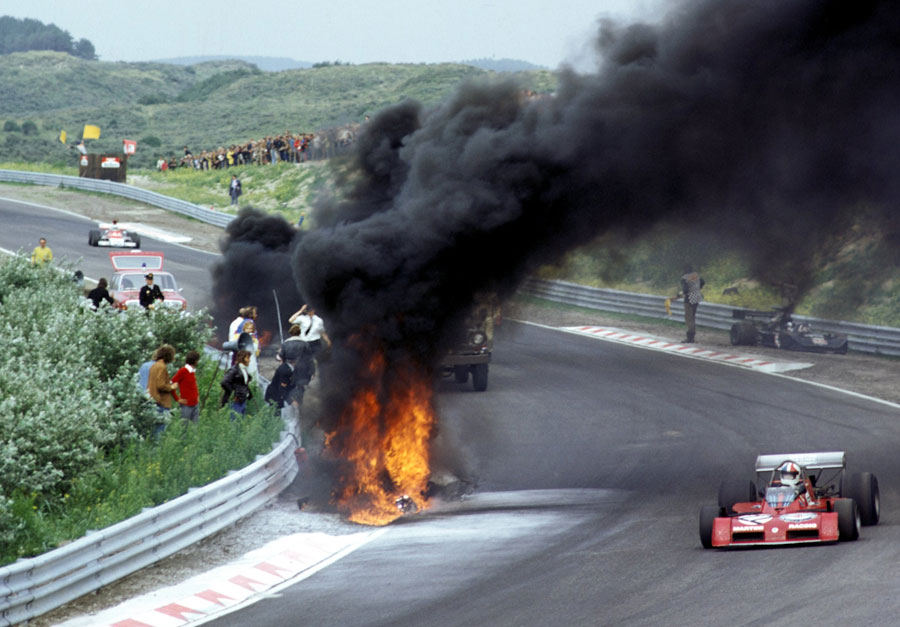 Chris Amon passes the March 731 of Roger Williamson following his crash on the eighth lap that would see him perish through asphyxiation, despite the efforts of David Purley
