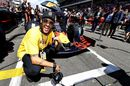 Neymar poses for a photo with the Red Bull RB15 on the grid