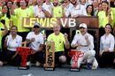 Race winner Lewis Hamilton and Valtteri Bottas celebrates with the team