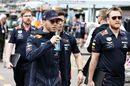 Pierre Gasly walks with his engineers in the Paddock