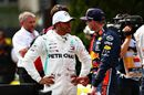 Pole sitter Lewis Hamilton talks with Max Verstappen in parc ferme