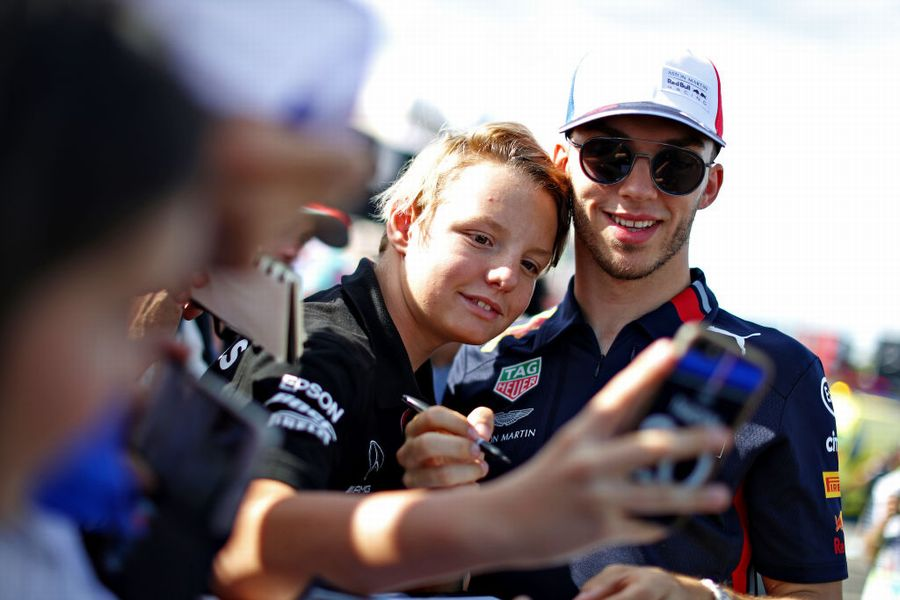 Pierre Gasly poses for a photo with fans