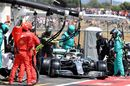 Lewis Hamilton makes a pit stop for new tyres