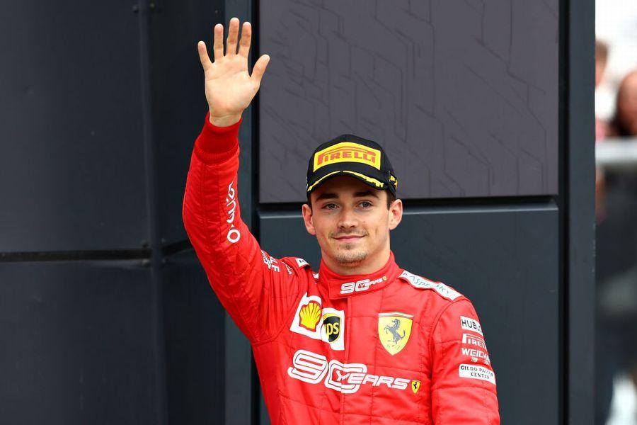 Charles Leclerc celebrate on the podium