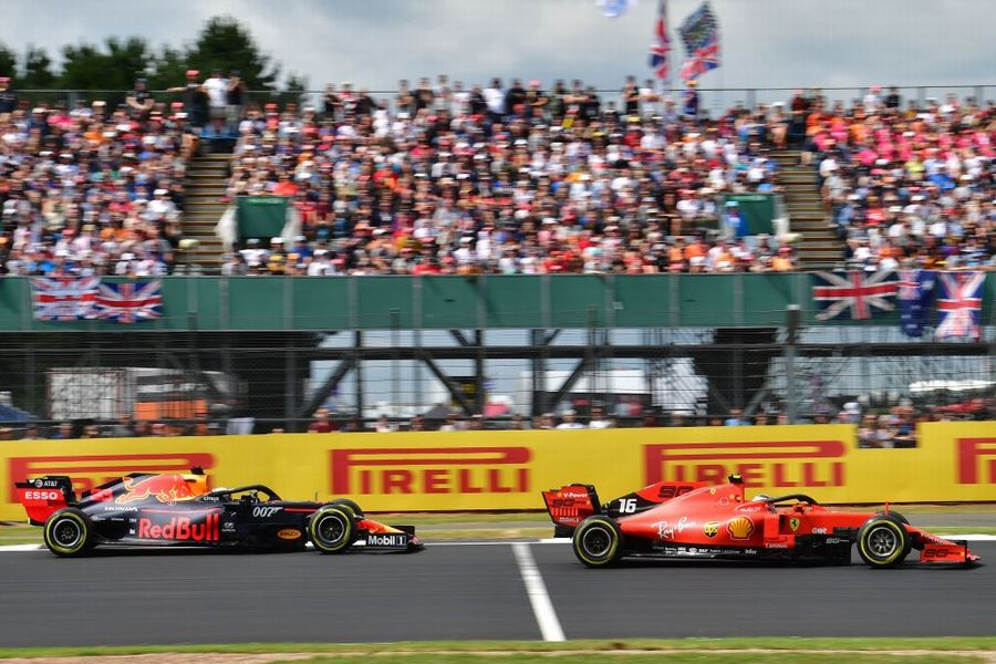 Charles Leclerc leads  Max Verstappen on track