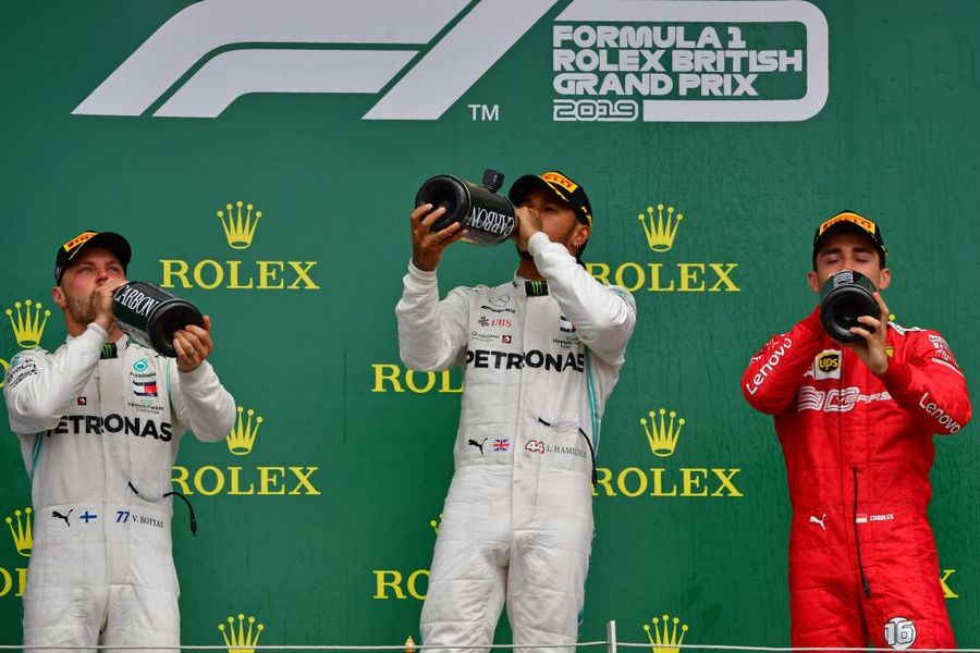 Top 3 drivers celebrate on the podium with the champagne