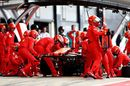 Sebastian Vettel makes a pitstop for a new front wing