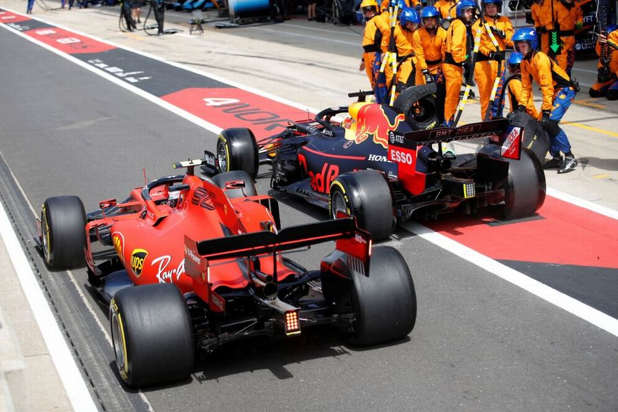 Charles Leclerc  Max Verstappen  battle for position in the pit lane