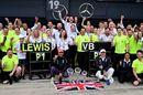 Race winner Lewis Hamilton and Valtteri Bottas celebrate with their team
