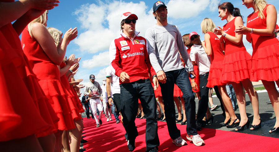 Fernando Alonso and Mark Webber head to the drivers' parade as Lewis Hamilton jumps the queue