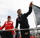 Fernando Alonso and Mark Webber wave to the crowd during the drivers' parade
