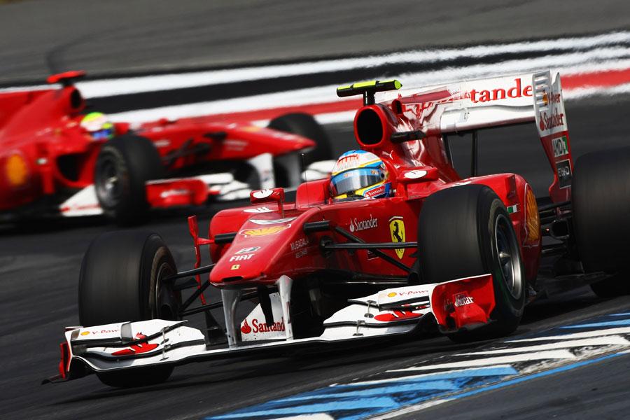 Fernando Alonso leads Felipe Massa after the Brazilian let him past