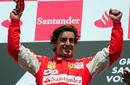 Fernando Alonso celebrates on the podium